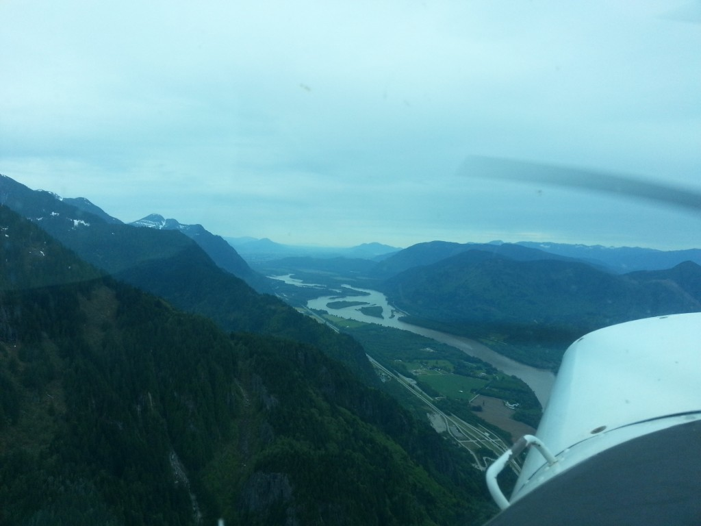 Over CYHE, facing back towards the lower mainland
